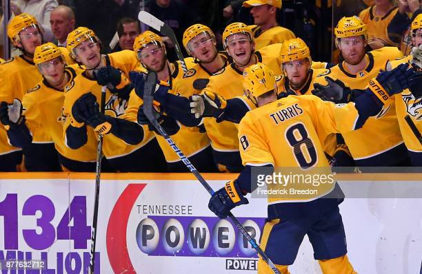 Kyle Turris of the Nashville Predators is congratulated by teammates after scoring a shootout goal against the Montreal Canadiens at Bridgestone...
