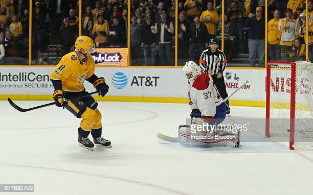 Kyle Turris of the Nashville Predators scores the game winning shootout goal against goalie Antti Niemi of the Montreal Canadiens at Bridgestone...
