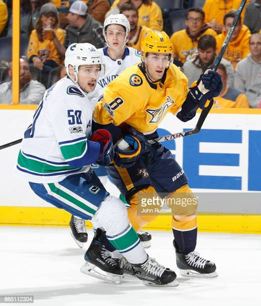 Kyle Turris of the Nashville Predators skates against Brendan Gaunce of the Vancouver Canucks during an NHL game at Bridgestone Arena on November 30...