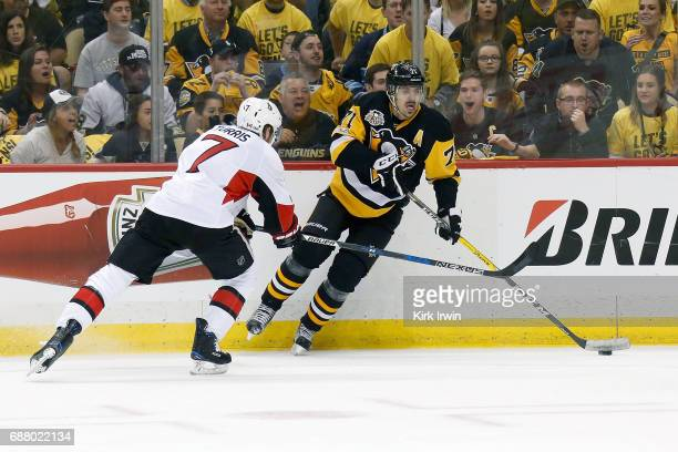 Kyle Turris of the Ottawa Senators attempts to check the puck away from Evgeni Malkin of the Pittsburgh Penguins in Game Five of the Eastern...