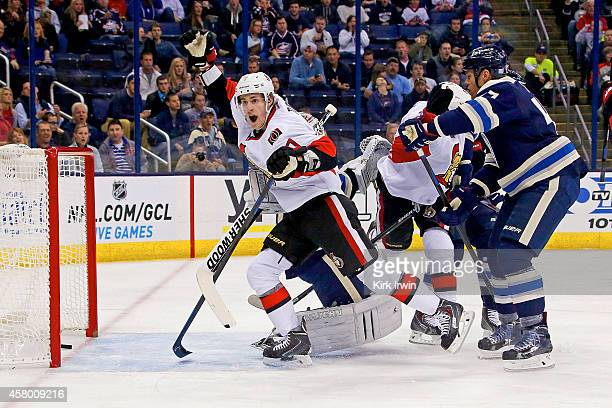 Kyle Turris of the Ottawa Senators celebrates after Clarke MacArthur of the Ottawa Senators redirected a shot past Curtis McElhinney of the Columbus...