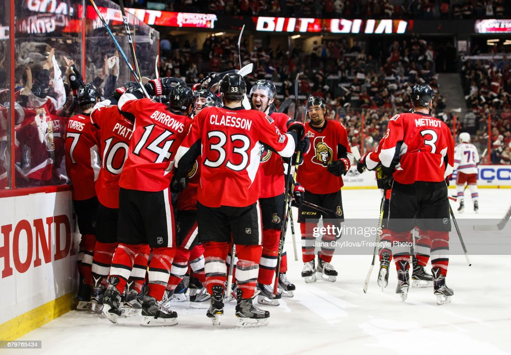 Kyle Turris #7 of the Ottawa Senators celebrates his overtime goal against the New York Rangers with teammates Tom Pyatt #10, Alexandre Burrows #14, Fredrik Claesson #33, Mark Stone #61 and Marc Methot #3in Game Five of the Eastern Conference Second Round during the 2017 NHL Stanley Cup Playoffs at Canadian Tire Centre on May 6, 2017 in Ottawa, Ontario, Canada.