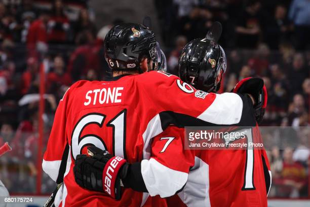 Kyle Turris of the Ottawa Senators celebrates his overtime goal with Mark Stone as he watches the replay against the New York Rangers in Game Five of...