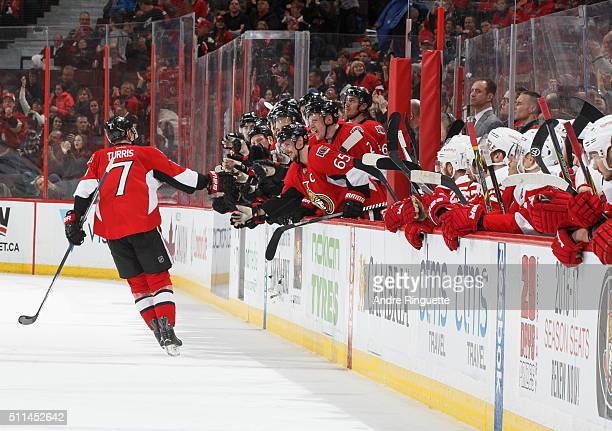Kyle Turris of the Ottawa Senators celebrates his shootout goal against the Detroit Red Wings with teammates including Erik Karlsson at Canadian Tire...