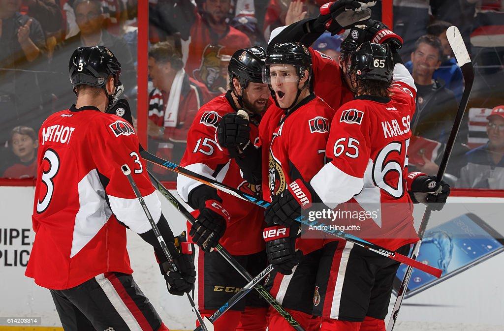 Kyle Turris #7 of the Ottawa Senators celebrates his third period goal against the Toronto Maple Leafs with teammates Marc Methot #3, Zack Smith #15 and Erik Karlsson #65 at Canadian Tire Centre during the season opener on October 12, 2016 in Ottawa, Ontario, Canada.