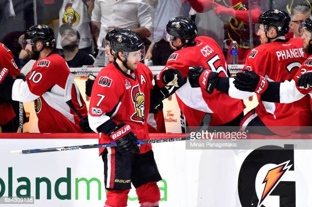 Kyle Turris of the Ottawa Senators celebrates with his teammates after scoring a goal against Matt Murray of the Pittsburgh Penguins during the...