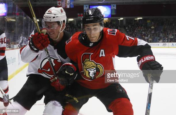 Kyle Turris of the Ottawa Senators checks Nathan Bastian of the New Jersey Devils during Kraft Hockeyville Canada on September 25 2017 at Credit...