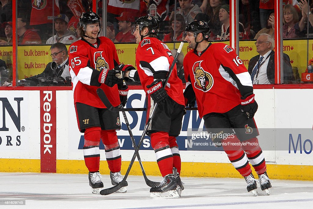 Kyle Turris #7 of the Ottawa Senators exchange a fist bump as he celebrates his third period goal with teammates Erik Karlsson #65 and Clarke MacArthur #16 during an NHL game against the Calgary Flames at Canadian Tire Centre on March 30, 2014 in Ottawa, Ontario, Canada.