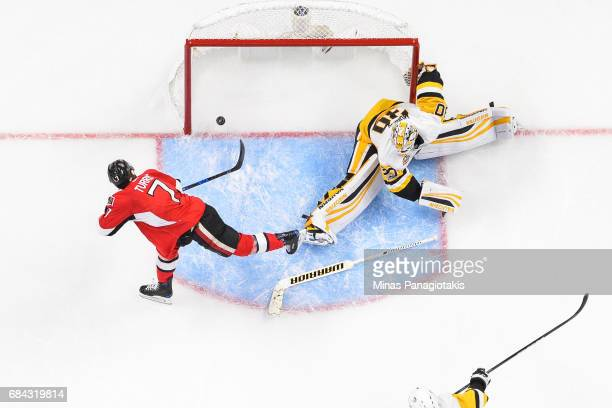 Kyle Turris of the Ottawa Senators scores on goaltender Matt Murray of the Pittsburgh Penguins during the second period in Game Three of the Eastern...