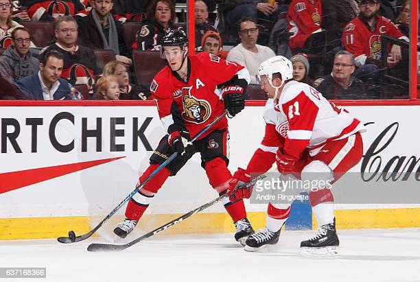 Kyle Turris of the Ottawa Senators skates against Luke Glendening of the Detroit Red Wings at Canadian Tire Centre on December 29 2016 in Ottawa...