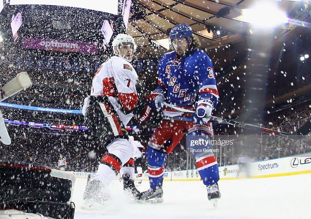 Kyle Turris #7 of the Ottawa Senators skates against Mats Zuccarello #36 of the New York Rangers at Madison Square Garden on December 27, 2016 in New York City.