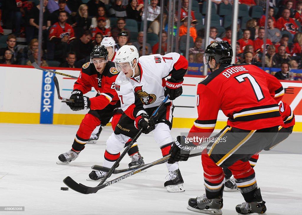 Kyle Turris #7 of the Ottawa Senators skates against Sean Monahan #23 and TJ Brodie #7 of the Calgary Flames at Scotiabank Saddledome on November 15, 2014 in Calgary, Alberta, Canada.