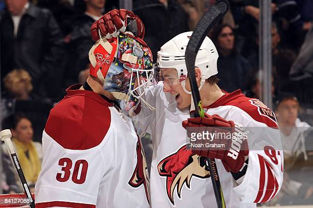 Kyle Turris of the Phoenix Coyotes congratulates teammate goalie Ilya Bryzgalov for a 21 win against the Los Angeles Kings on December 26 2008 at...