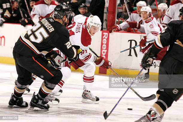Kyle Turris of the Phoenix Coyotes handles the puck as Chris Pronger of the Anaheim Ducks defends during the game on October 12 2008 at Honda Center...