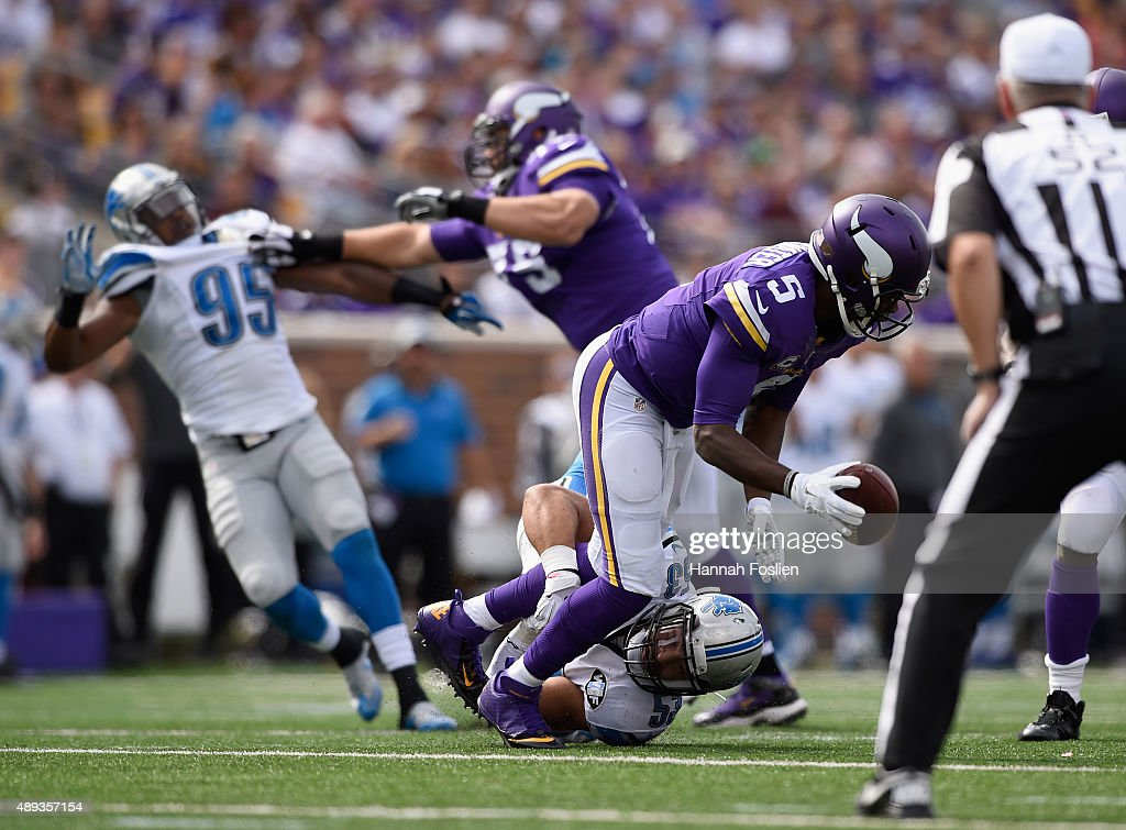Kyle Van Noy #53 of the Detroit Lions attempts to tackle Teddy Bridgewater #5 of the Minnesota Vikings during the second quarter of the game on September 20, 2015 at TCF Bank Stadium in Minneapolis, Minnesota. Bridgewater was able to pass the ball to teammate Adrian Peterson #28 on the play. The Vikings defeated the Lions 26-16.