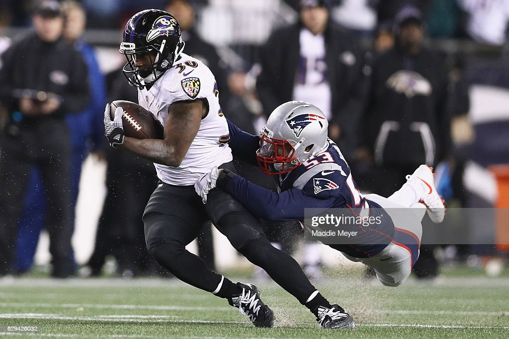 Kyle Van Noy #53 of the New England Patriots attempts to tackle Kenneth Dixon #30 of the Baltimore Ravens during the second half at Gillette Stadium on December 12, 2016 in Foxboro, Massachusetts.