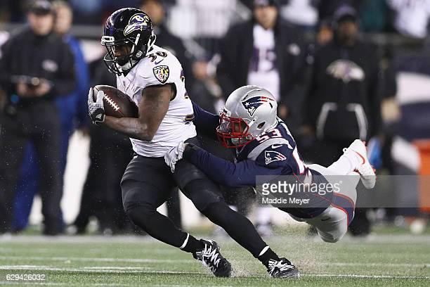 Kyle Van Noy of the New England Patriots attempts to tackle Kenneth Dixon of the Baltimore Ravens during the second half at Gillette Stadium on...