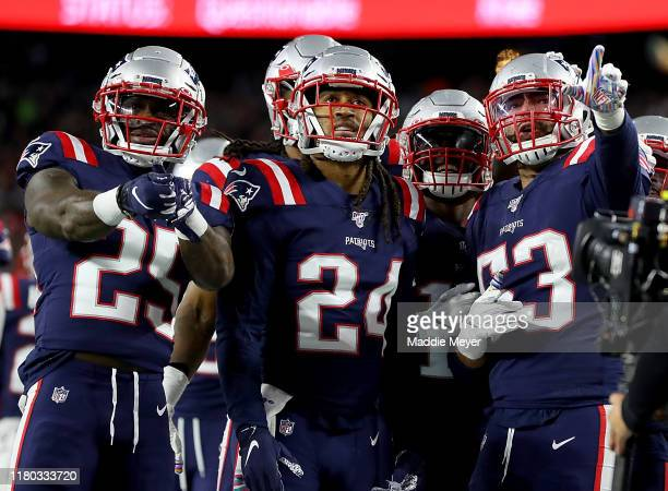Kyle Van Noy of the New England Patriots celebrates with his teammates Terrence Brooks Stephon Gilmore and Matthew Slater after recovering a fumble...