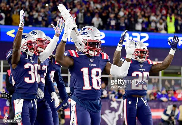 Kyle Van Noy of the New England Patriots celebrates with his teammates Jason McCourty Matthew Slater and Terrence Brooks after recovering a fumble to...