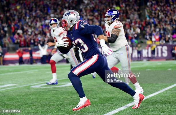 Kyle Van Noy of the New England Patriots runs the ball for a touchdown after recovering a fumble lost by Jon Hilliman of the New York Giants during...