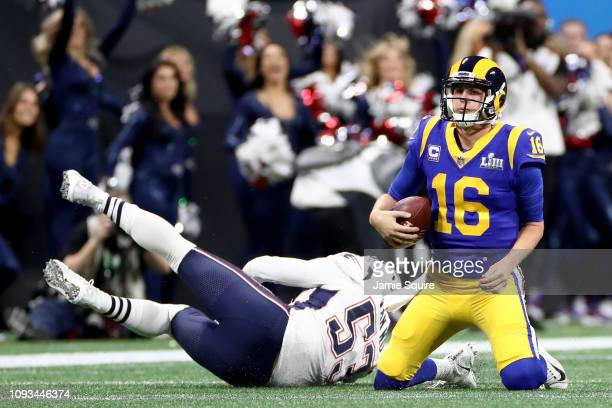 Kyle Van Noy of the New England Patriots sacks Jared Goff of the Los Angeles Rams in the first half during Super Bowl LIII at Mercedes-Benz Stadium...