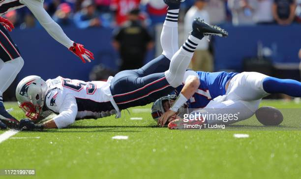 Kyle Van Noy of the New England Patriots sacks Josh Allen of the Buffalo Bills and causes a fumble during the first half at New Era Field on...