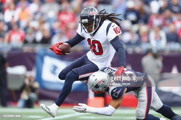 Kyle Van Noy of the New England Patriots tackles DeAndre Hopkins of the Houston Texans during the second half at Gillette Stadium on September 9,...