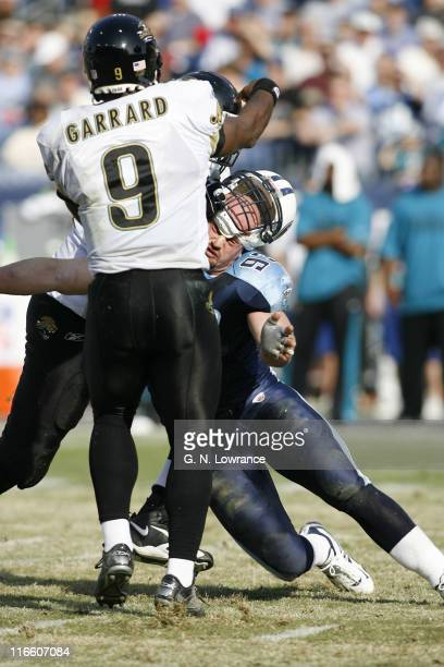 Kyle Vanden Bosch of the Titans has his helmet come off while making a hit on David Garrard during 1sthalf action between the Jacksonville Jaguars...