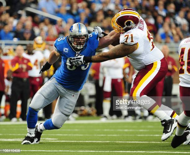 Kyle Vanden Busch of the Detroit Lions rushes against Trent Williams of the Washington Redskins at Ford Field on October 31 2010 in Detroit Michigan