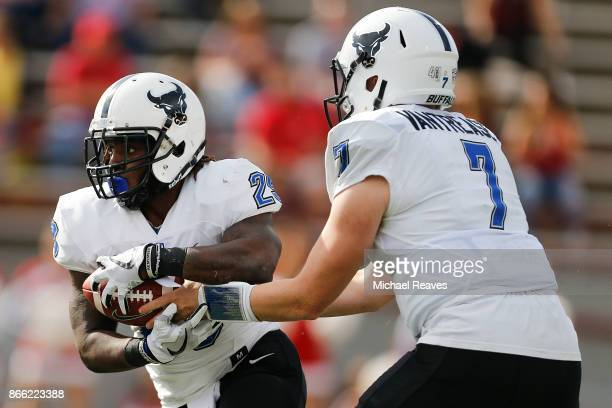 Kyle Vantrease of the Buffalo Bulls hands the ball off to Emmanuel Reed against the Miami Ohio Redhawks at Yager Stadium on October 21 2017 in Oxford...