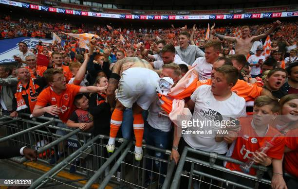 Kyle Vassell of Blackpool celebrates with the fans the Sky Bet League Two Playoff Final match between Blackpool and Exeter City at Wembley Stadium on...