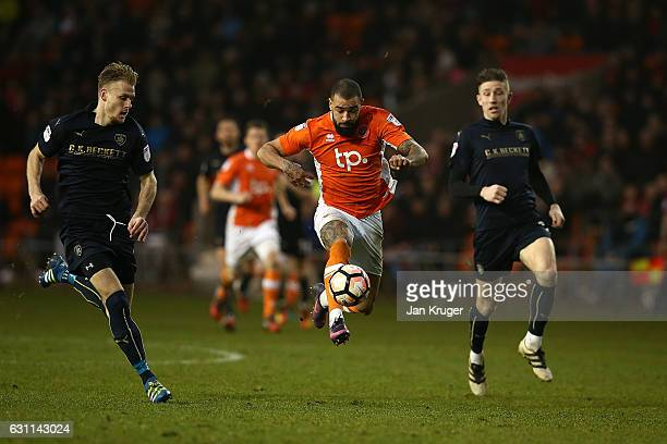 Kyle Vassell of Blackpool controls the ball under pressure from Marc Roberts and Angus MacDonald of Barnsley during The Emirates FA Cup Third Round...