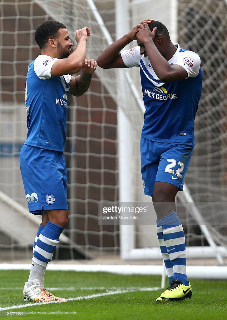 Kyle Vassell of Peterborough celebrates with Ricardo Santos after he scores to make it 2-0 during the Sky Bet League One match between Peterborough United and Port Vale at London Road Stadium on September 6, 2014 in Peterborough, England.