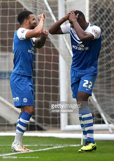 Kyle Vassell of Peterborough celebrates with Ricardo Santos after he scores to make it 20 during the Sky Bet League One match between Peterborough...