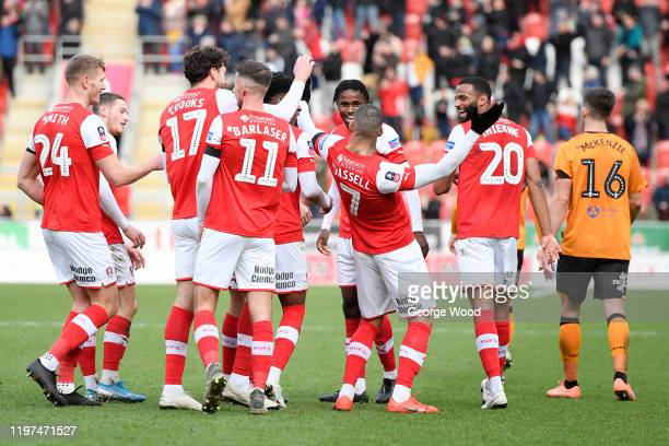 Kyle Vassell of Rotherham United celebrates with teammates after scoring his team's second goal during the FA Cup Third Round match between Rotherham...