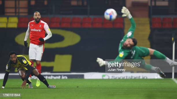 Kyle Vassell of Rotherham United has a shot saved by Ben Foster of Watford during the Sky Bet Championship match between Watford and Rotherham United...