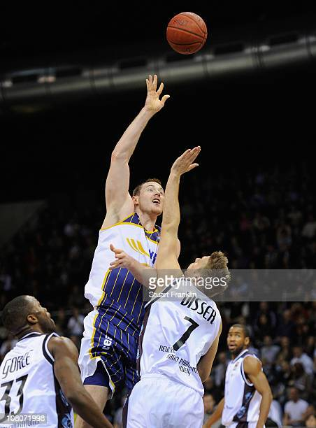 Kyle Visser of Braunschweig challenges Aron Baynes of Oldenburg during the Beko BBl game between Phantoms Braunschweig and EWE Baskets Oldenburg at...