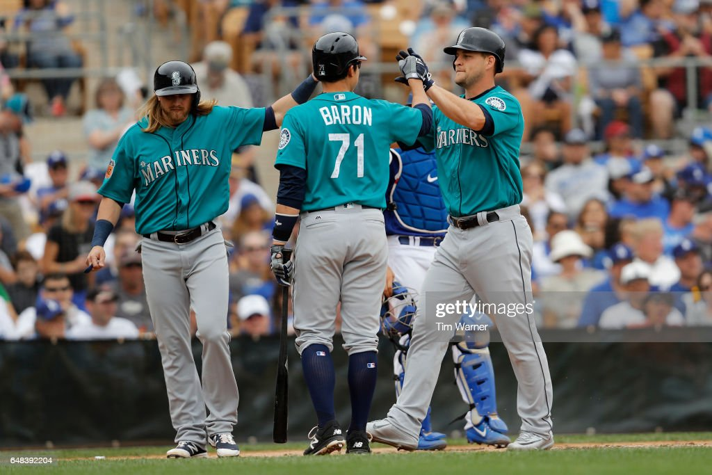 Kyle Waldrop #44 of the Seattle Mariners is greeted by Steven Baron #71 and Taylor Motter #21 after a home run against the Los Angeles Dodgers in the sixth inning of the spring training game at Camelback Ranch on March 5, 2017 in Glendale, Arizona.