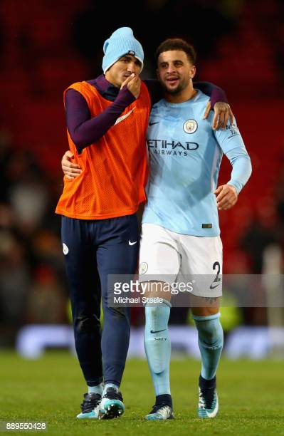 Kyle Walker and Danilo of Manchester City react after the Premier League match between Manchester United and Manchester City at Old Trafford on...