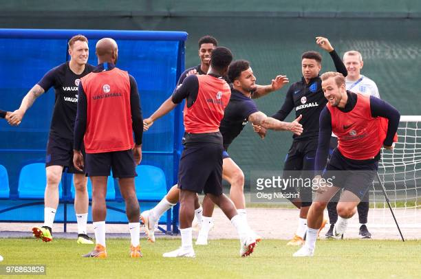 Kyle Walker and Harry Kane of England enjoy a drill during a training session during the England Media Access at on June 17 2018 in Saint Petersburg...