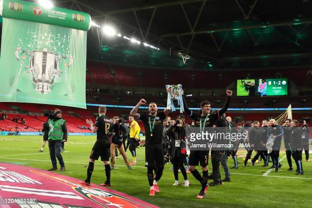 Kyle Walker and John Stones of Manchester City celebrate with the Carabao Cup at full time of the Carabao Cup Final between Aston Villa and...