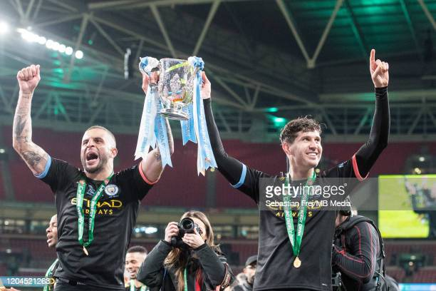 Kyle Walker and John Stones of Manchester City lift the Carabao Cup trophy after the Carabao Cup Final between Aston Villa and Manchester City at...