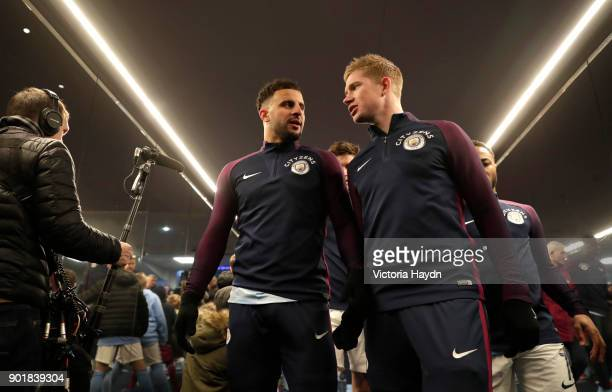 Kyle Walker and Kevin De Bruyne of Manchester City talk at half time during the The Emirates FA Cup Third Round match between Manchester City and...
