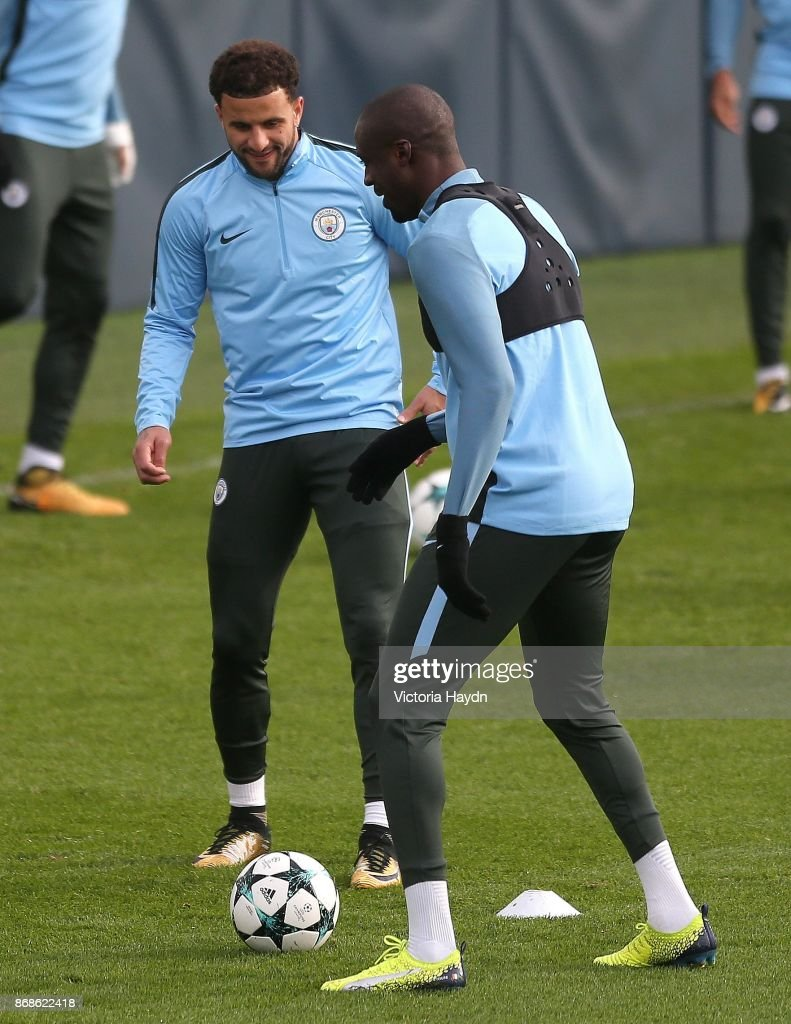 Kyle Walker and Yaya Toure in action during training at Manchester City Football Academy on October 31, 2017 in Manchester, England.