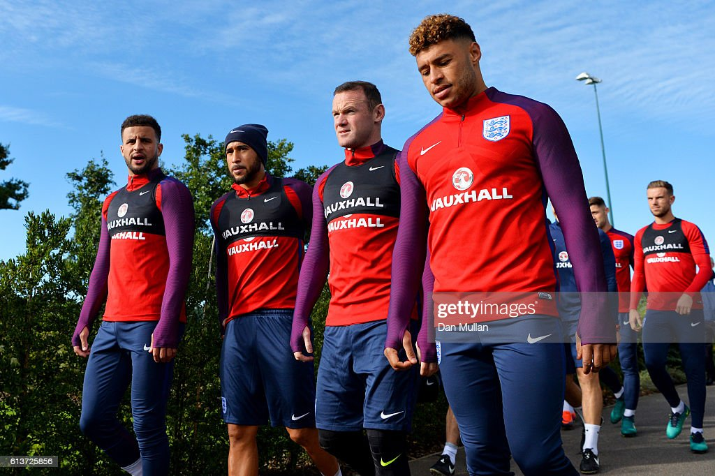 Kyle Walker, Andros Townsend, Wayne Rooney and Alex Oxlade-Chamberlain walk out for an England training session at the Tottenham Hotspur training ground on October 10, 2016 in Enfield, England.