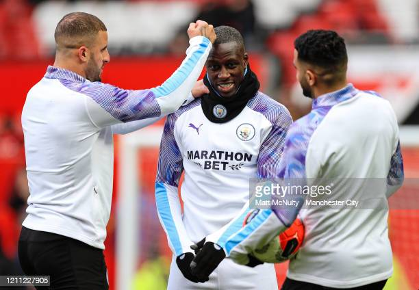 Kyle Walker Benjamin Mendy and Riyad Mahrez of Manchester City share a joke during the Premier League match between Manchester United and Manchester...