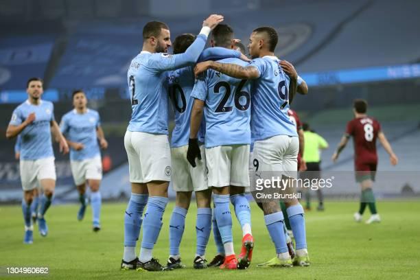 Kyle Walker, Bernardo Silva, Riyad Mahrez, Gabriel Jesus and Raheem Sterling of Manchester City celebrate their first goal, which was an own goal...