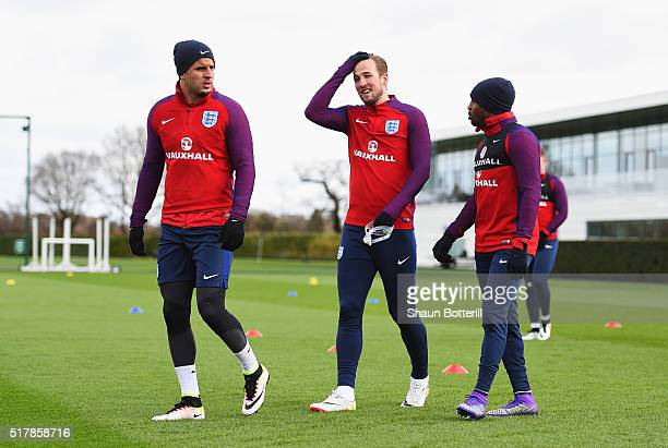 Kyle Walker Harry Kane and Danny Rose of England talk during a training session prior to the International Friendly match against the Netherlands at...