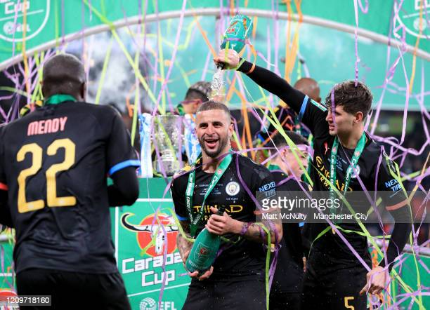 Kyle Walker John Stones and Benjamin Mendy of Manchester City celebrate following victory during the Carabao Cup Final between Aston Villa and...