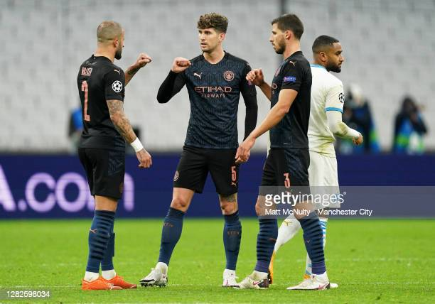 Kyle Walker, John Stones and Ruben Dias of Manchester City celebrate victory at full time during the UEFA Champions League Group C stage match...